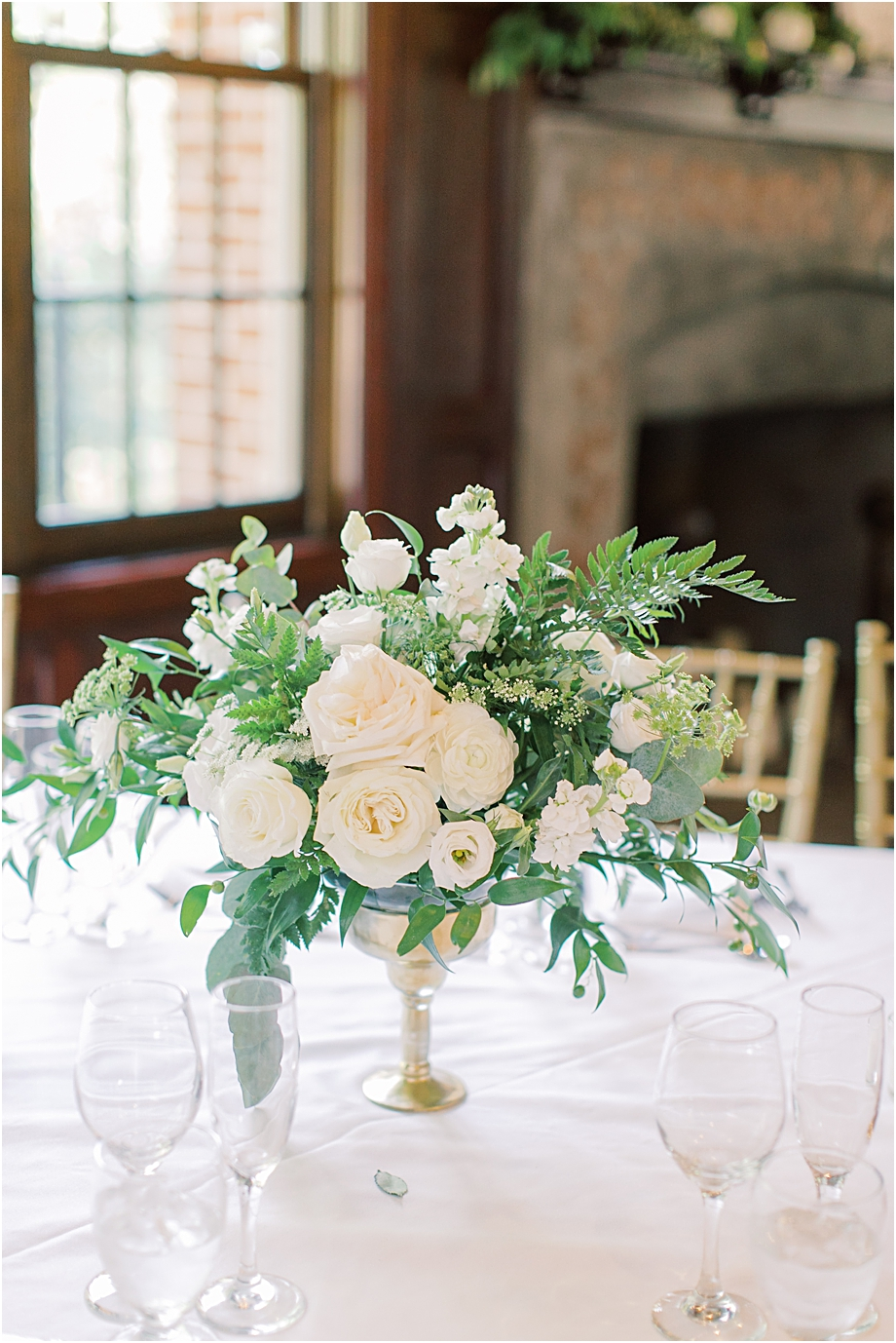 white floral centerpiece | | hotel du village wedding