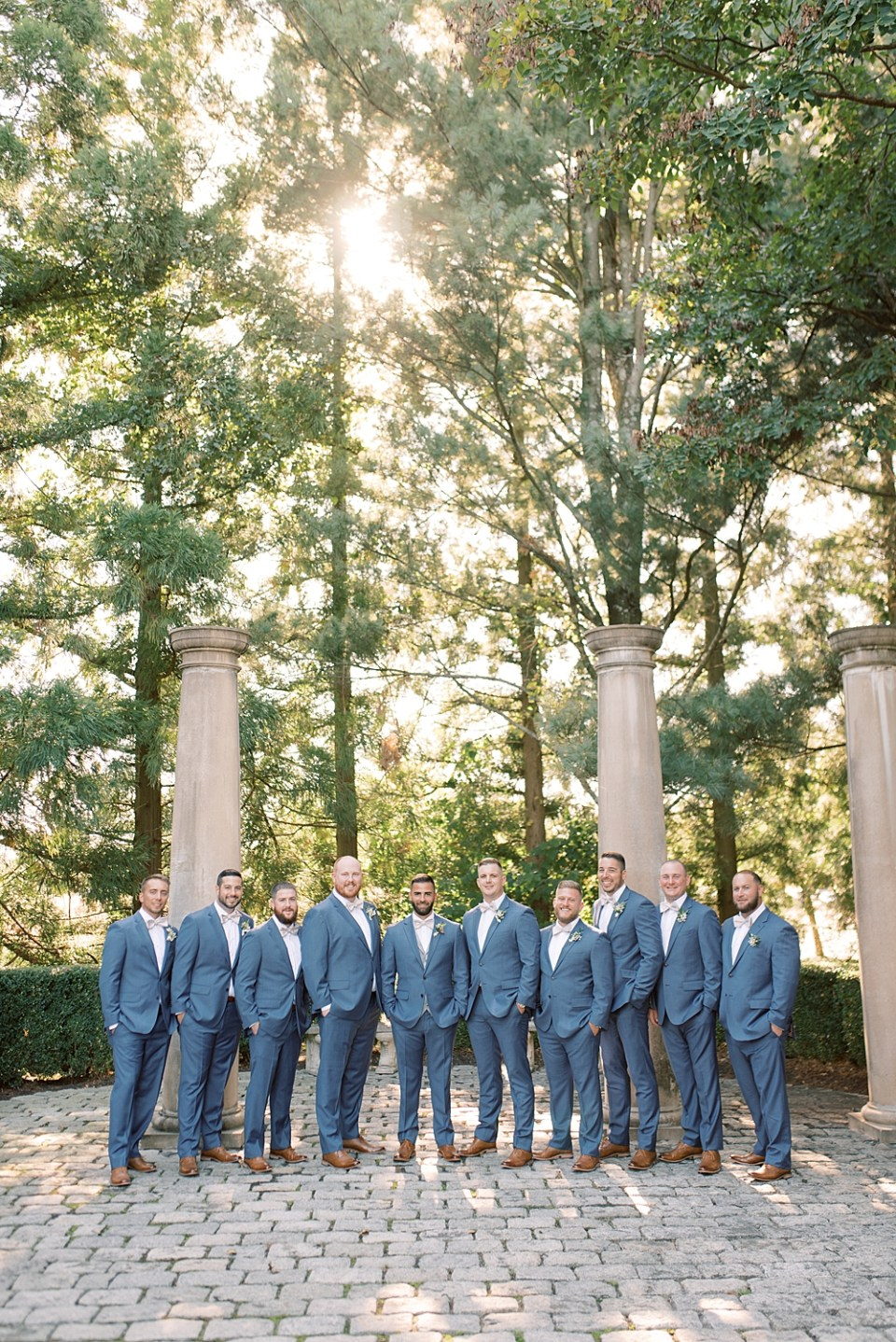 groom with groomsmen in blue suits   ashford estate wedding photography   sarah canning photography