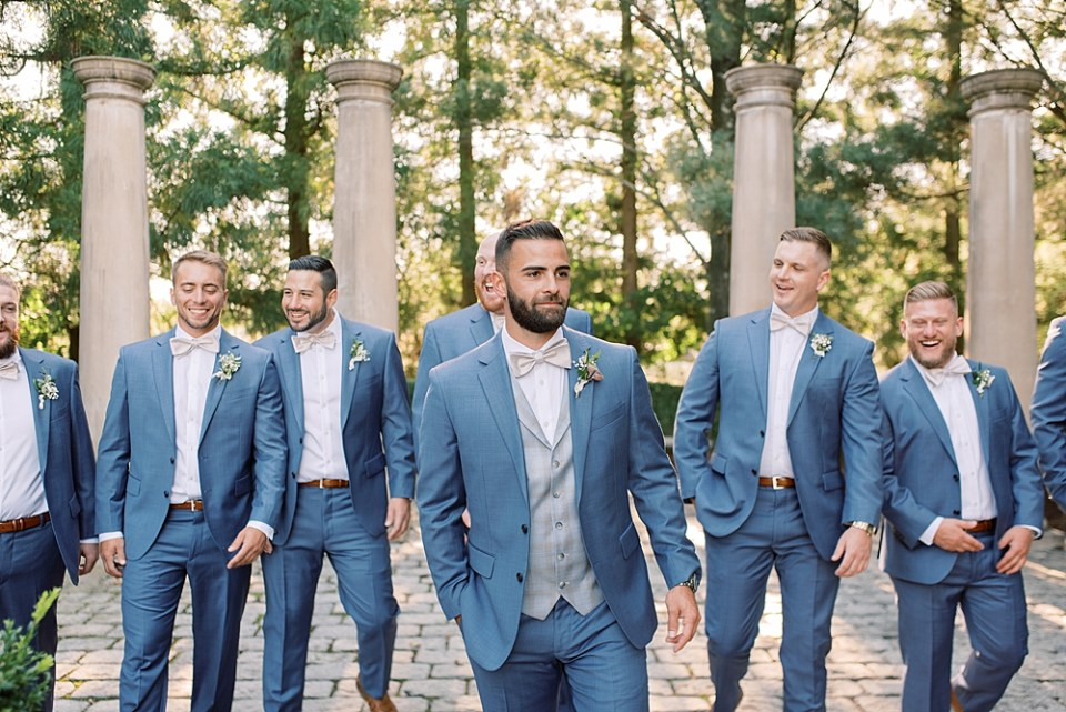 blue and silver groom attire   groom walking with groomsmen   sarah canning photography