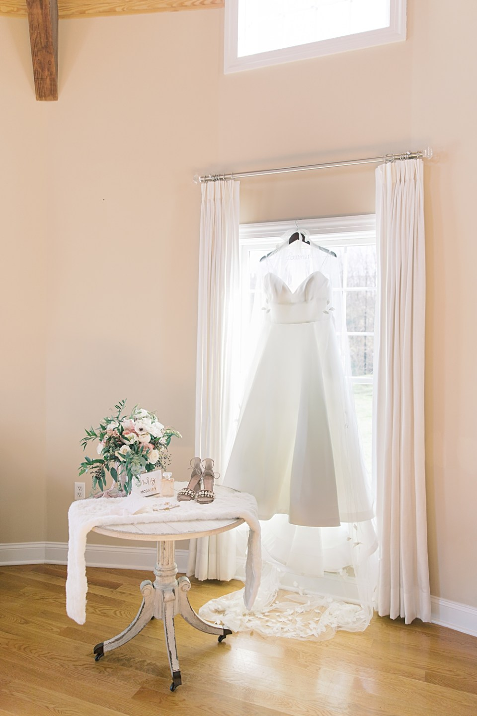 dress hanging in window | bear brook valley bridal suite | sarah canning photography