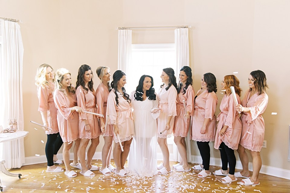bride popping confetti with her bridesmaids | bear brook valley bridal suite | nj wedding photographer sarah canning