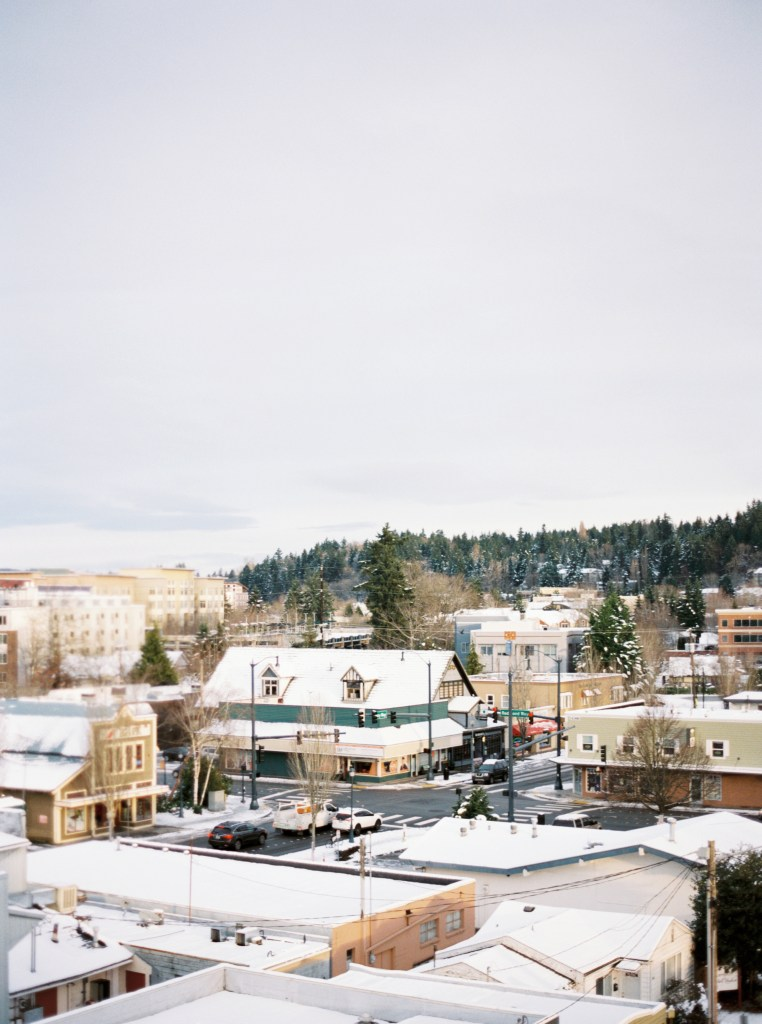 View of Redmond after snow, when the town is covered in white but the sun is shining. Shot on film and processed by Photovision Prints.