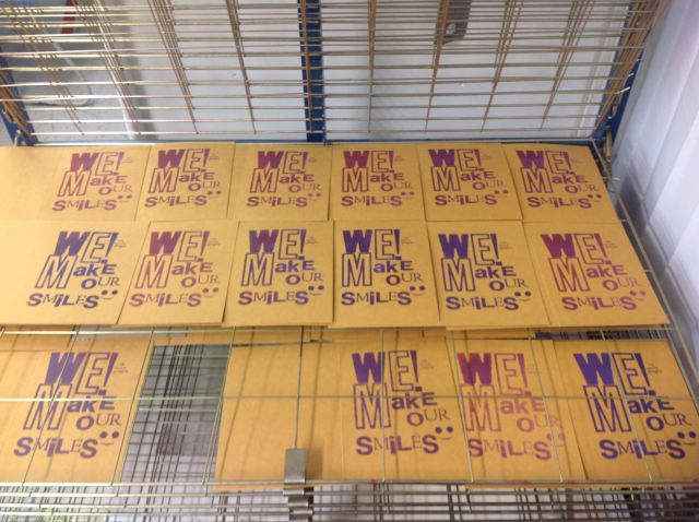 We Make Our Smiles prints on the drying rack