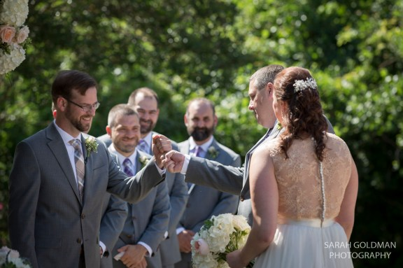 brother and groom bump fists
