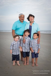 grandsons with their grandparents on the beach