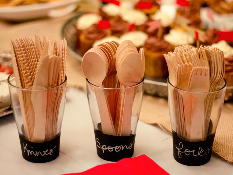 wood utensils in chalkboard labeled cups