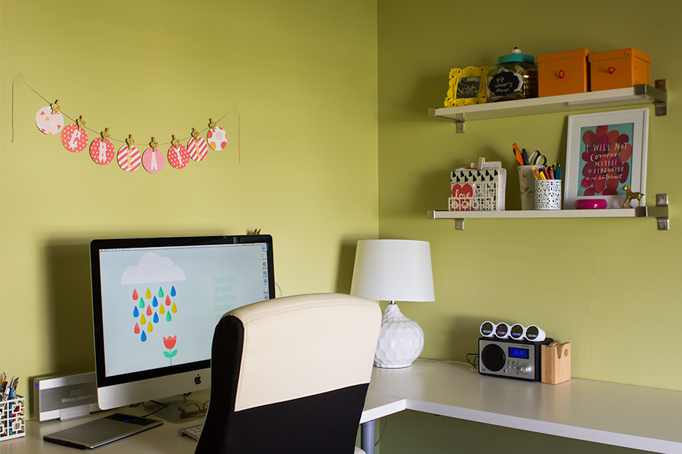 A cozy, organized home office that doubles as a craft room.