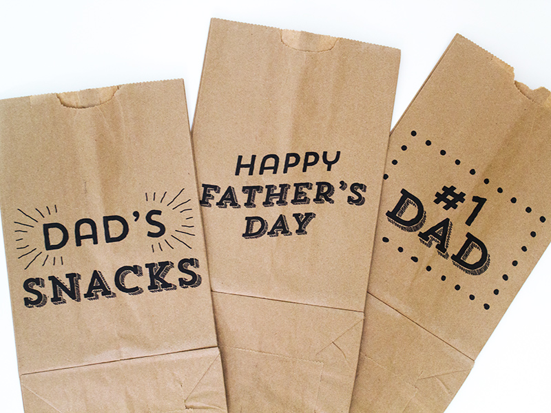 Wrap up treats for dad in these cute printable brown paper bags. This tutorial shows you how to make them using your home printer.
