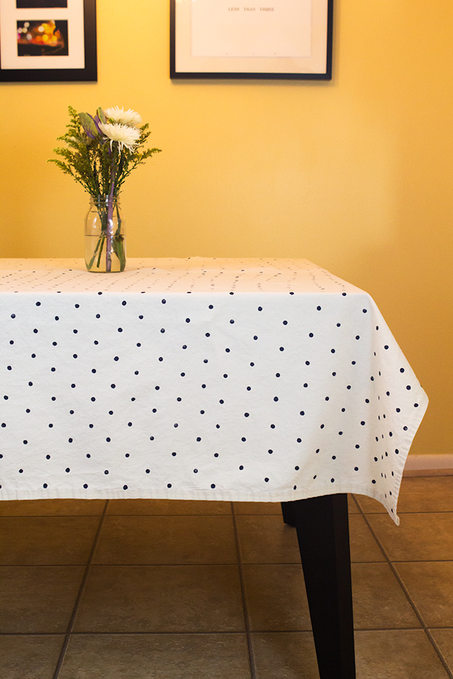 Transform a solid tablecloth or drop cloth into a stylish Kate Spade inspired tablecloth with only two supplies!