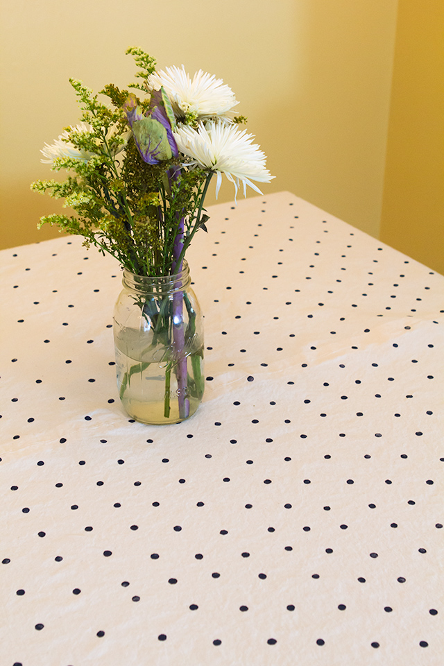 This Kate Spade inspired tablecloth was created using craft paint and a pencil eraser as a stamp. It's a perfect any occasion tablecloth!