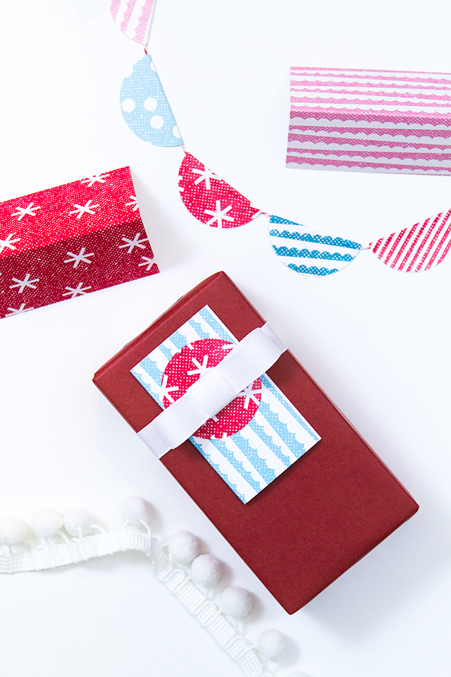 Swap traditional Christmas colors for this cheerful, modern palette. Click through to download the free printable gift tags, monogram labels and more.