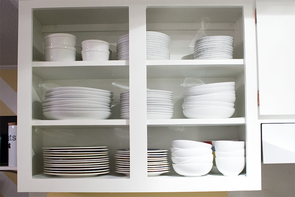 Love this open shelving looks! It was created by just removing the existing cabinet doors and patching the holes.