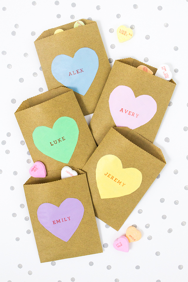 Give your friends something sweet this Valentine's Day! Paint up a bunch of these conversation heart treat bags.
