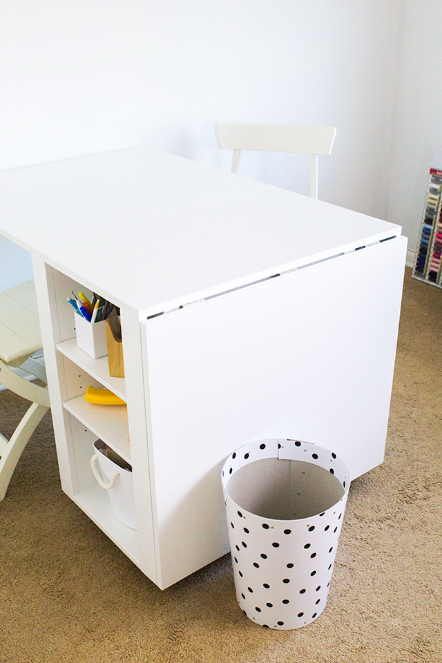 This hobby table can be rolled away when not in use and has tons of workspace, perfect for a tiny craft room.