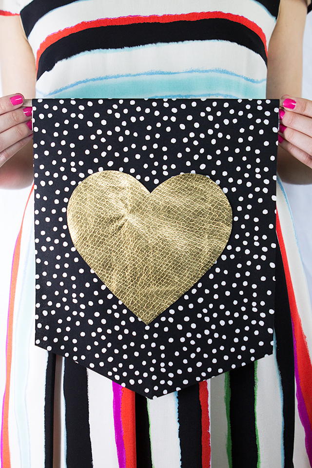 This DIY heart wall hanging is the perfect decoration for Valentine's Day but it's so cute you'll want to leave it up after February 14th!