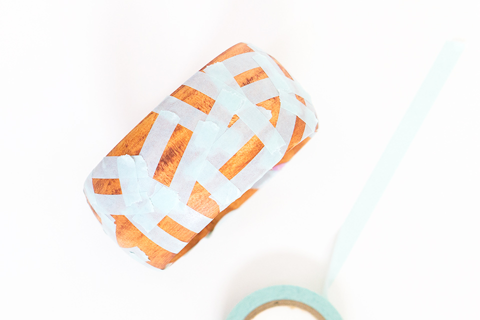 Thin washi tape arranged in small rectangles make the perfect stencils for making confetti painted wood bangle bracelets.