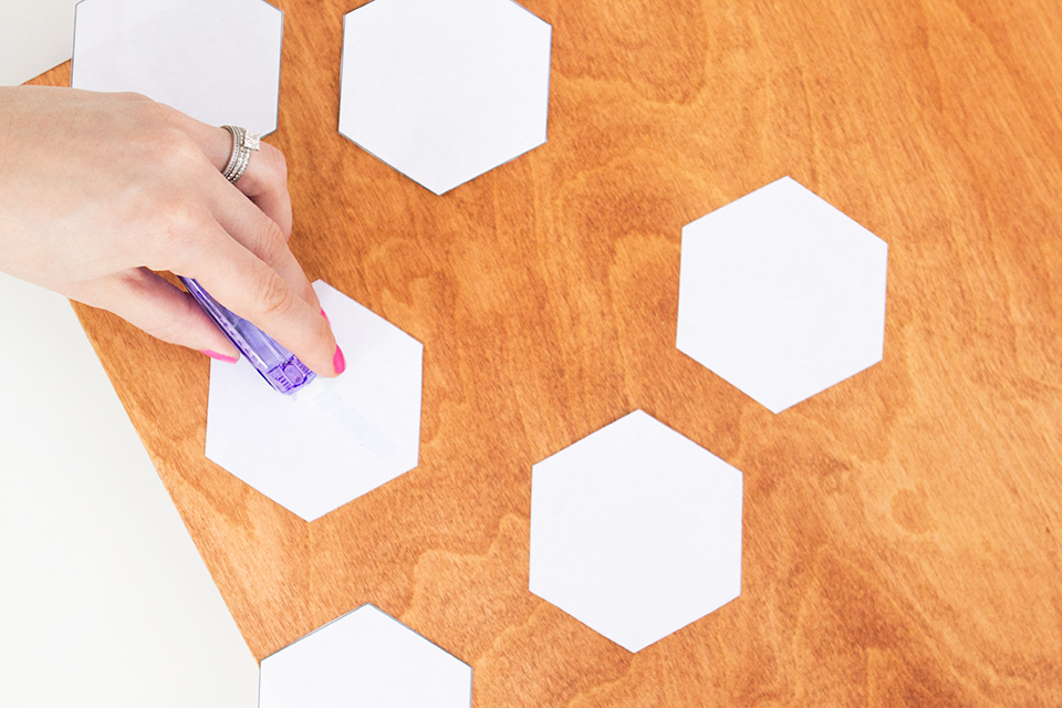 Paper hexagons are used as a template for creating this lovely geometric wall art.