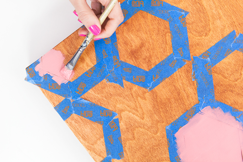 Use painters tape to create stencils and make your own geometric wall art. (Click through for full tutorial and to see the final piece)