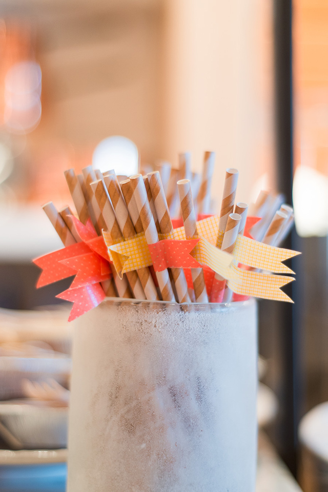 Use washi tape to create colored flags on paper drinking straws that match your party decor perfectly.