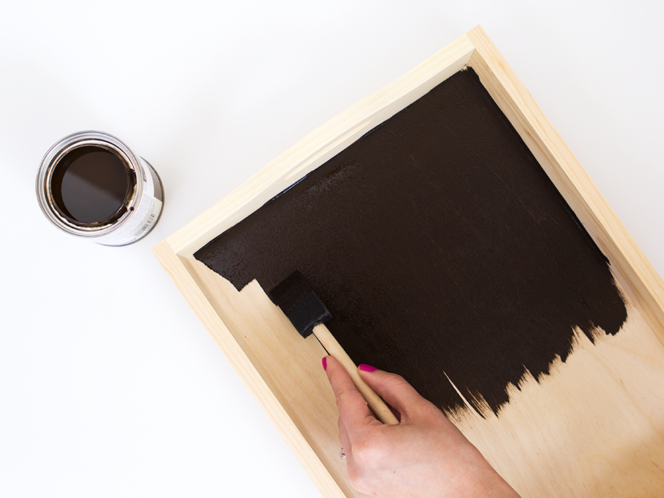 Use dark walnut wood stain to transform a plain unfinished wood tray into a new stylish polka dot tray.