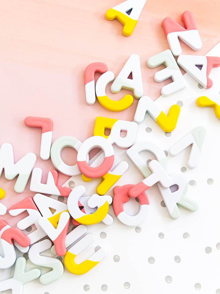 Transform kids alphabet magnets by spray painting them bright white and dipping them in paint! (click through for video tutorial)