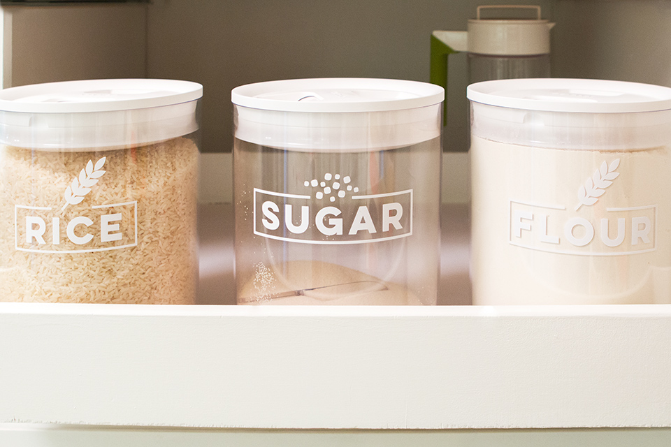 Loving these stackable storage canisters with pretty labels. Click through to download the cut files to make your own labels!