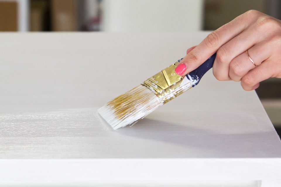 DecoArt Chalky Finish paint sticks to any surface, even laminate, without priming.