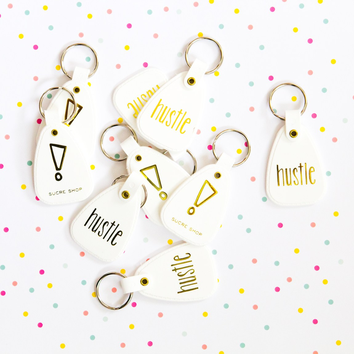 Hustle metallic gold keychains by Sucre