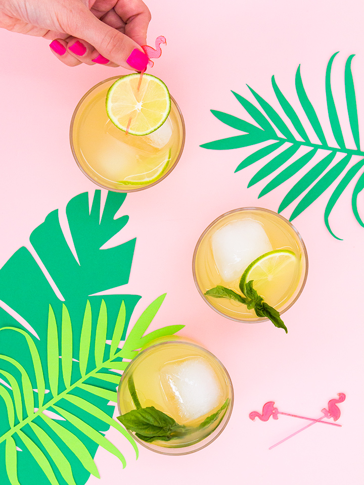 Guava, pear, and pineapple juices are combined with fresh basil and Smirnoff 21 to make a refreshing summertime punch.