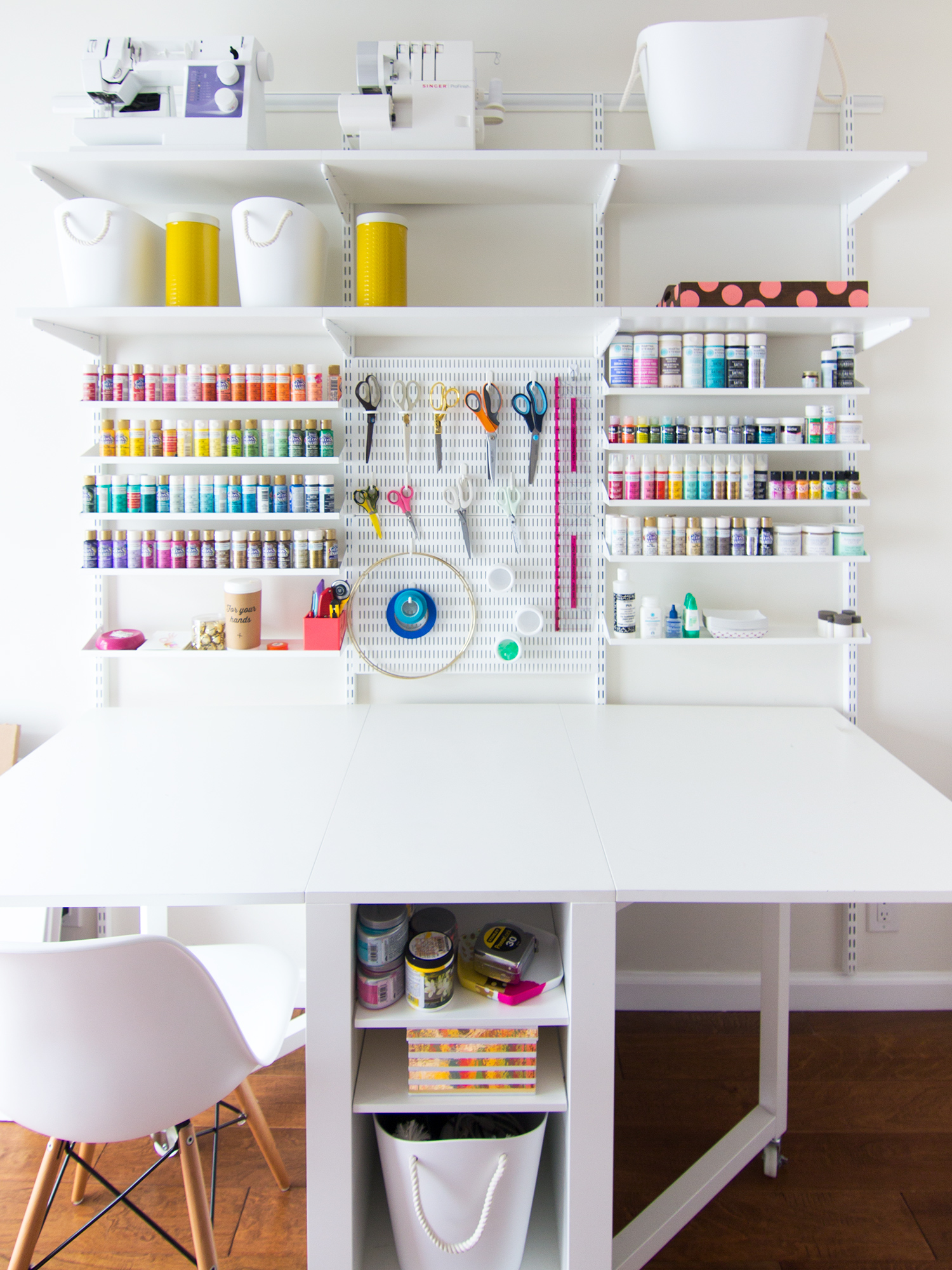 A place for everything in this organized home office and craft room!