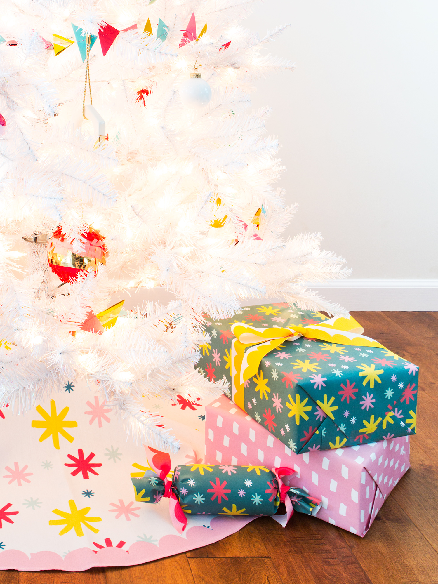 This colorful tree skirt is the perfect compliment to a white Christmas tree!