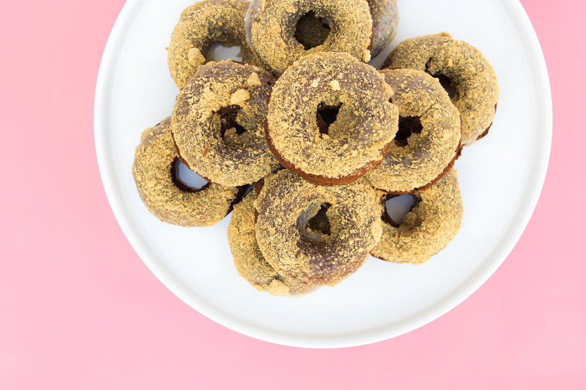 Bake up a batch of these delicious s'mores donuts for your valentine! They are chocolate chocolate chip donuts with a marshmallow graham cracker glaze. Yum!