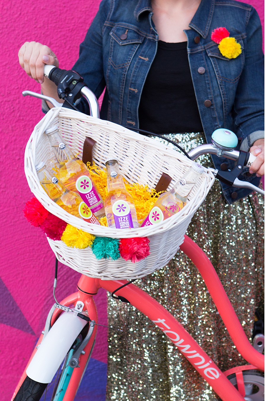 Add some sparkle to your bike by creating this easy DIY pom pom bike basket! Created in partnership with @IZZEOfficial