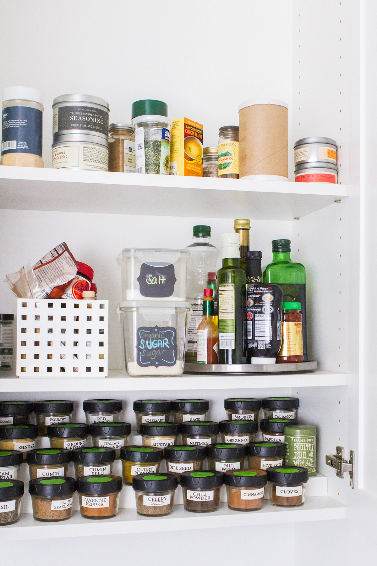 Great organization for spices in a kitchen cabinet.