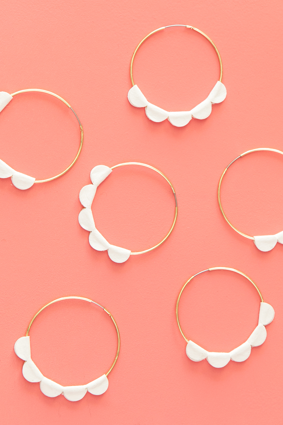 Learn how to create your own scalloped statement hoop earrings in minutes using a Silhouette Cameo or Portrait! Click through to watch video tutorial and download the cut files.