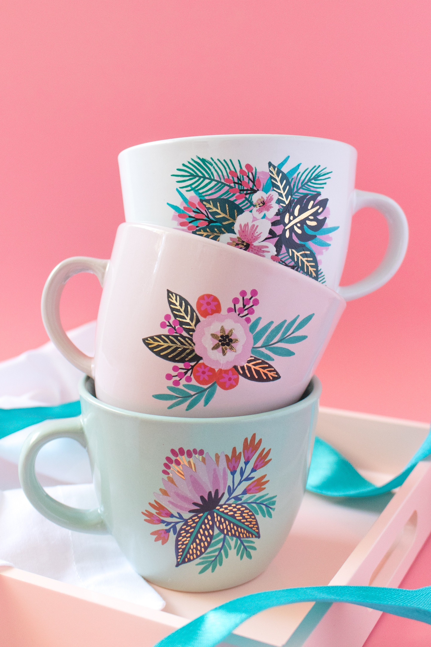 Photo of stacked floral mugs