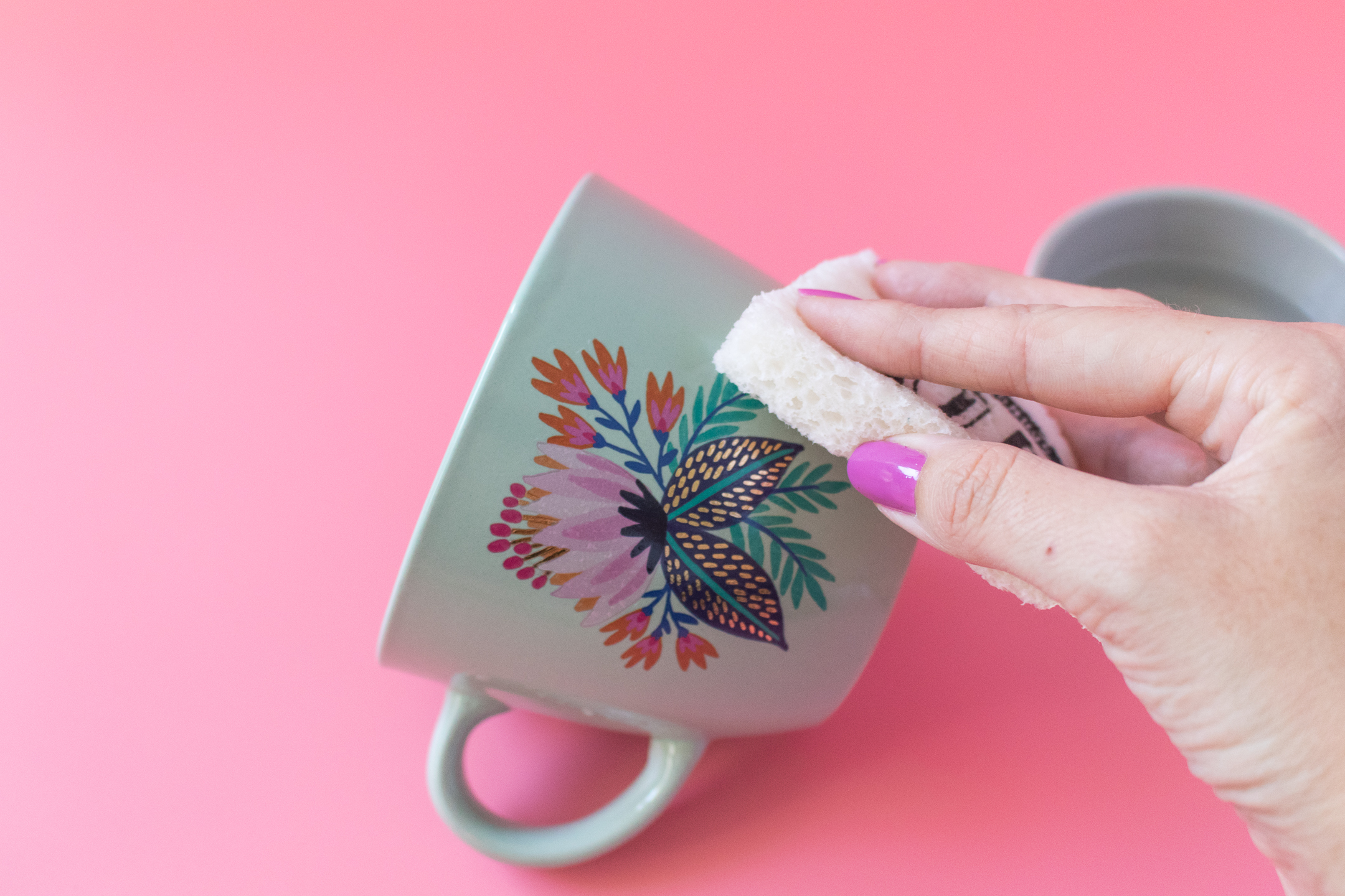 Photo of sponge applying a temporary tattoo to ceramics.