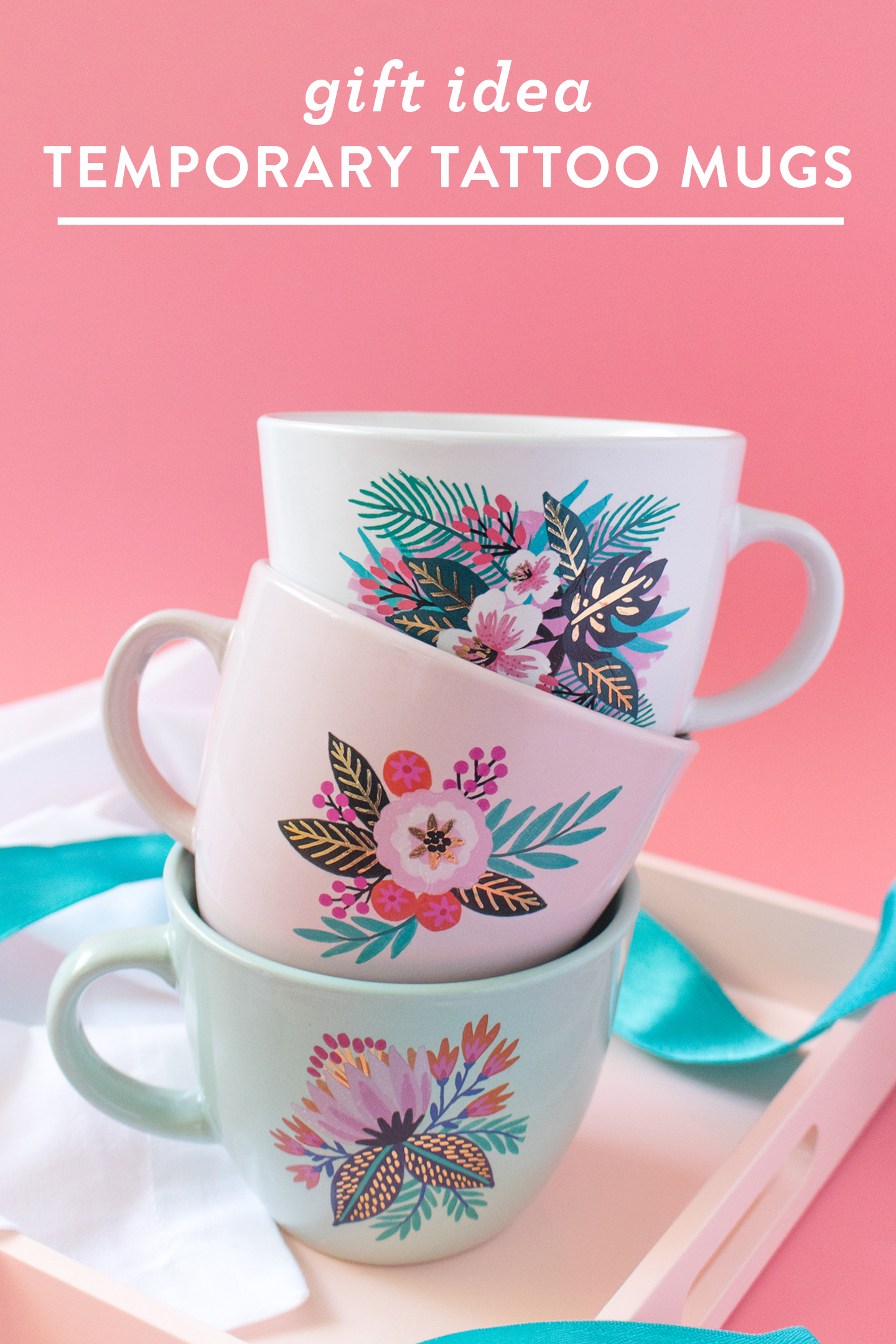 Photo of stacked floral mugs decorated with temporary tattoos
