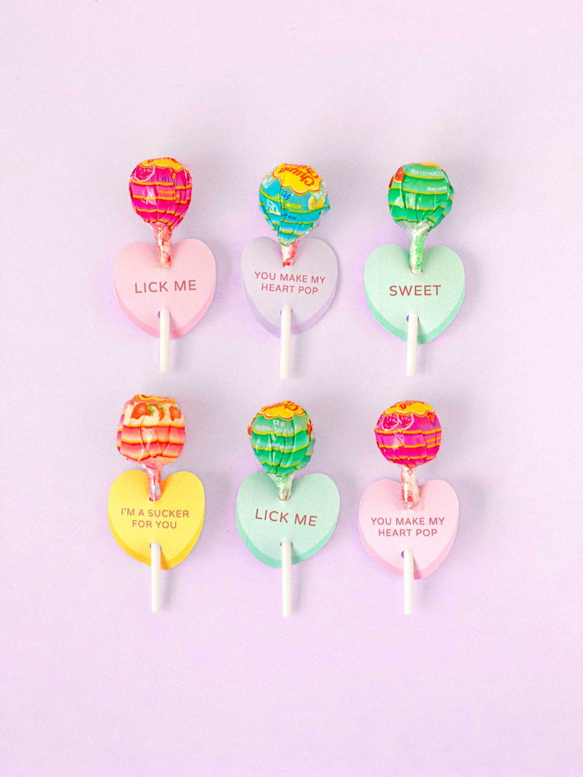 Photo of printable lollipop cards in the shape of conversation heart candy.