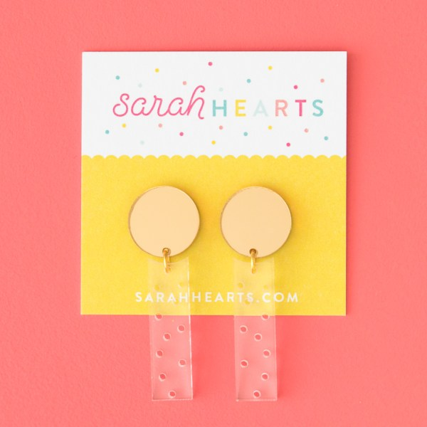 Photo of mirrored gold and clear acrylic polka dot earrings