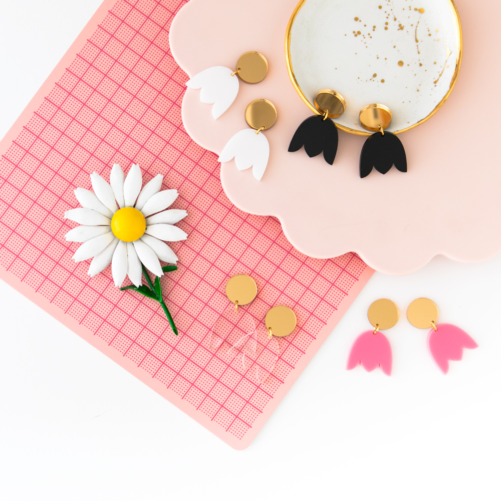 Tulip shaped laser cut acrylic earrings flatlay