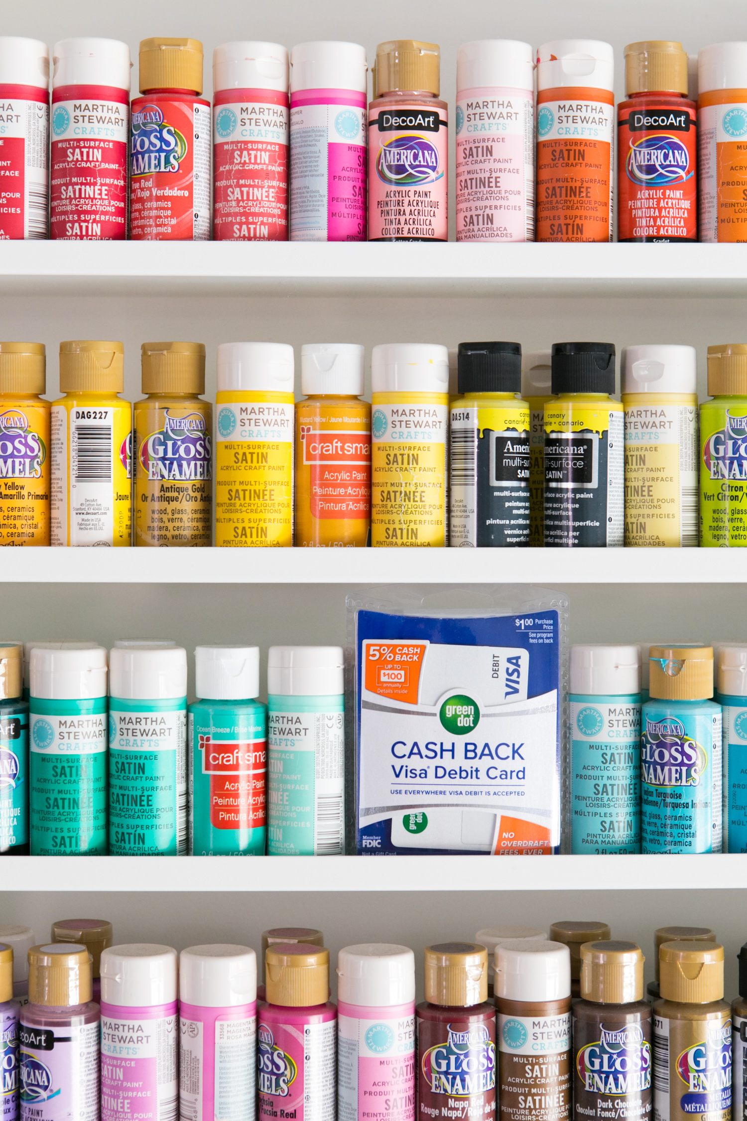 Colorful wall of craft paint bottles