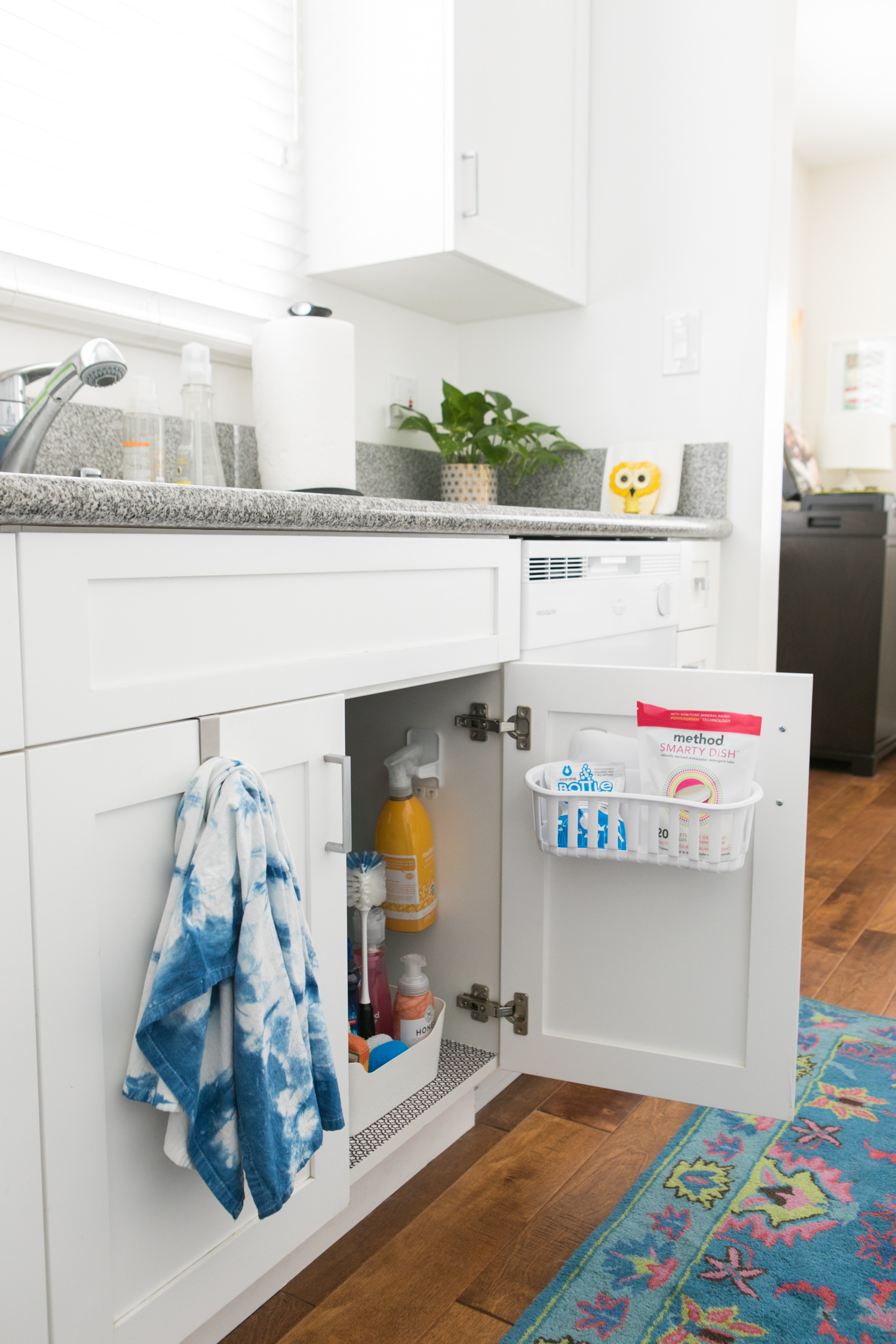 How to Organize Under the Kitchen Sink - Sarah Hearts