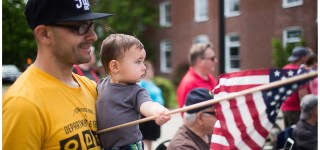 image of baby and father holding a flag