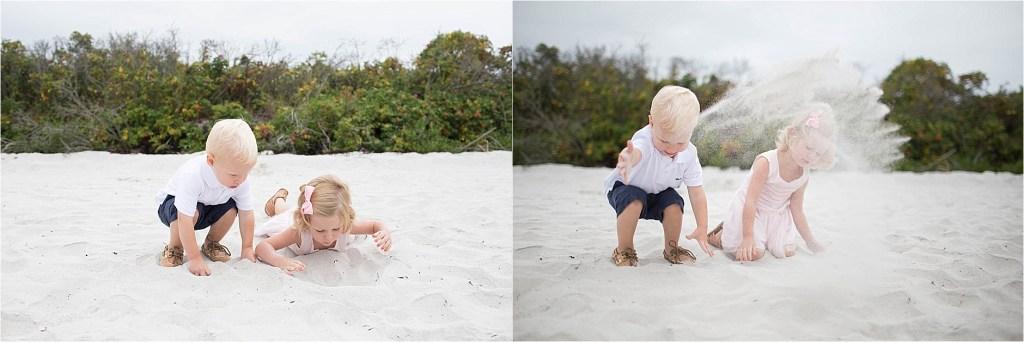 Little kids throwing sand on beach Pemaquid Beach Maine Sarah Jane Photography