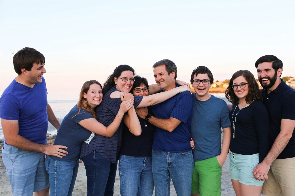 Group Hug on York Maine Short Sands Beach extended family portrait Sarah jane photography