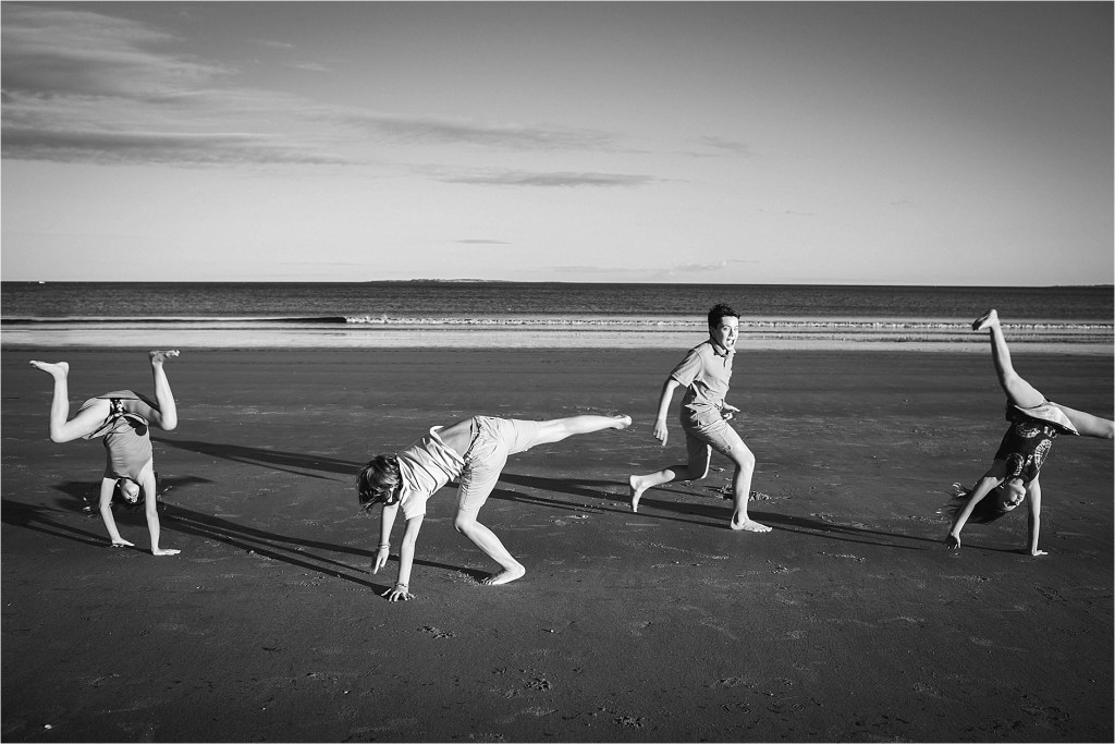 Kids doing cartwheels on the beach Old Orchard beach Maine Family Photographer