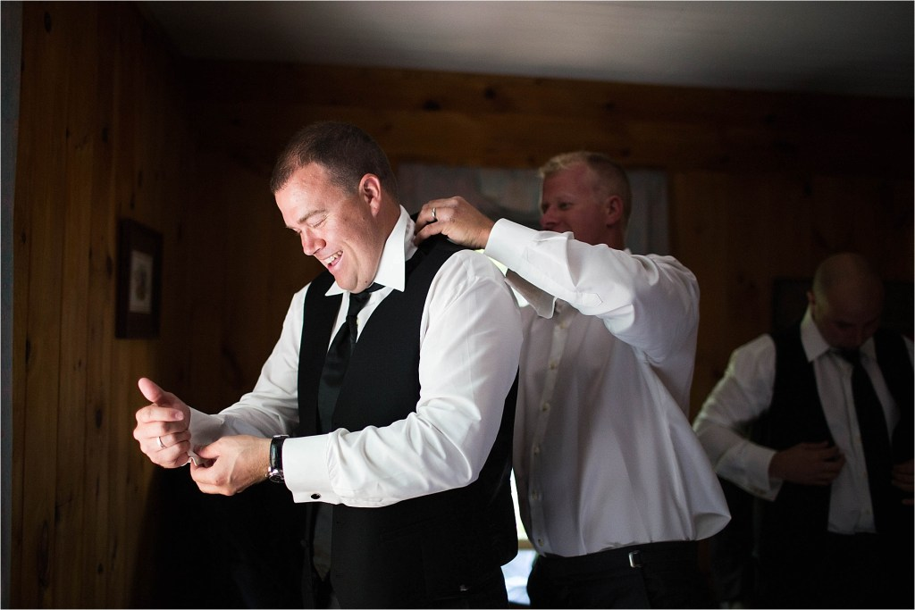 Groom getting ready Maine Wedding Photographer Pleasant Point Inn Lakeside