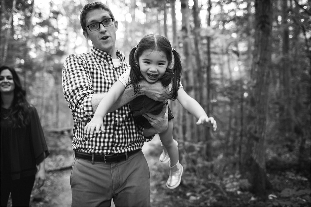 Dad giving child airplane ride, black and white photo, family portraitsMaine Family Photographer