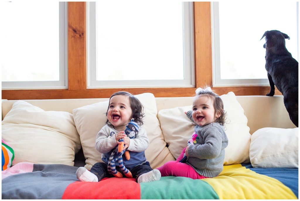 twins smiling for camera during family photography session